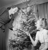 Mrs Devereux and her daughter celebrate Christmas at their home in Pinner, Middlesex, 1944.