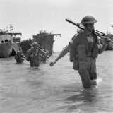 British troops wade ashore during the invasion of Sicily, 10 July 1943.