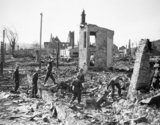 Troops pick through the ruins of Namsos in Norway after a German air raid, April 1940.