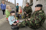 Soldiers of 1st Battalion, Cheshire Regiment befriend local children in the Garvaghy Road, Portadown, Armagh, 6 July 1998.</br></br></br>