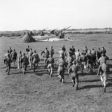 Crews rush to their 3.7-inch guns, 127th Heavy Anti-Aircraft Regiment, Southwold, Suffolk, 9 October 1944.