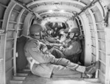 Paratroopers inside the fuselage of a Whitley aircraft at RAF Ringway, August 1942.
