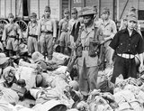 A Gurkha soldier guards Japanese prisoners on their way to POW camps outside Bangkok, September 1945.