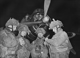 Four 'stick' commanders of 22nd Independent Parachute Company, 6th Airborne Division, synchronising their watches in front of an Armstrong Whitworth Albemarle at about 11 pm on 5 June 1944, just prior to take off from RAF Harwell in Oxfordshire.