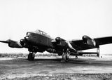 Avro Lancaster B Mk I (Special) of No. 617 Squadron, loaded with a 'Grand Slam' 22,000-lb deep-penetration bomb, running up its engines at Woodhall Spa, Lincolnshire, 1944.