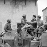 A scout car crew of 6th Duke of Connaught's Own Lancers, Indian Armoured Corps, chat with youngsters in San Felice, during the advance towards the River Sangro, Italy, 7 November 1943.