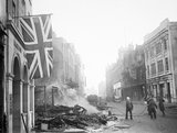 A Union Flag hangs defiantly from a building in the aftermath of the air raid which devastated the centre of Coventry on the night of 14/15 November 1940.