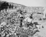 British soldiers making improvised grenades from jam tins filled with scraps of metal, barbed wire and shell fragments during the Gallipoli Campaign in 1915.