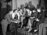 The concert party of 1st Battalion King's Shropshire Light infantry rehearsing at La Belle Porte near Mouchin in France, 28 December 1939.