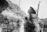 A sentry in the front line trenches at Blaireville using mirror periscope, 16th April 1916.