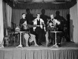 Men of the 1st Battalion The King's Shropshire Light Infantry stage a concert party in France, 28 December 1939.