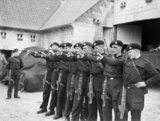 Men of 4th Royal Tank Regiment practising with their .38 revolvers in a farmyard near Arras, 6 October 1939.