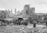 German prisoners being marched through the Cathedral Square in Ypres on 20th September 1917.