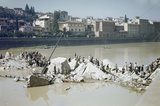 Italian civilians clambering over the ruins of the Ponte Alle Grazia, one of the bridges over the River Arno destroyed by the Germans before evacuating Florence, 14 August 1944.