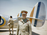 Field Marshal Jan Smuts, Prime Minister of the Union of South Africa, standing in front of a Lockheed Lodestar aircraft of No. 234 Squadron SAAF.