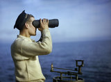 Leading Seaman Walker keeps a look-out from the bridge of HM Submarine TRIBUNE, September 1942.