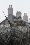 2nd Lieutenant Robin Martin and Rifleman Andy Walker of 1st Royal Green Jackets man a street barricade in Belfast during the Battalion's first tour of duty in Northern Ireland, 1969.