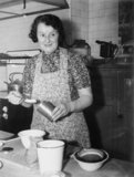 Mrs Lillie Taylor of Oldham, Lancashire, at work in the Ministry of Food kitchen during 1942 as one of 25 housewives selected to show cookery experts how a variety of food could be produced from rations.
