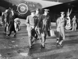 """The Prime Minister, Winston Churchill in RAF uniform, accompanied by Air Chief Marshal Sir Charles Portal, Chief of the Air Staff, leaving Consolidated Liberator """"Commando"""" of No. 24 Squadron RAF at Lyneham, Wiltshire, on their return from the Casablanca"""