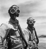 Two Chinese soldiers wearing gas masks at Pihu Military Training Centre in south eastern China.