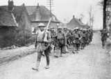 Men from a battalion of the 55th Division marching through Bethune, 10 April 1918.