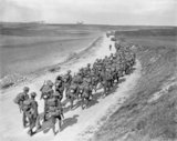 British infantry moving forward near Mailly-Maillet to meet the German advance, 26 March 1918.