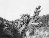 """Troops supposedly """"going over the top"""" at the start of the Battle of the Somme in 1916. In reality the photo was taken during a training exercise."""