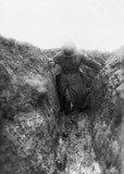 An Australian officer wading through the mud, Gird Trench, Gueudecourt.