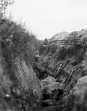 Battle of Albert. British troops in a support trench awaiting their turn to advance. Note wire cutter attached to rifle. 1st July 1916.