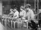 Women war workers gauge shells at Royal Shell Factory 3 at Woolwich Arsenal.