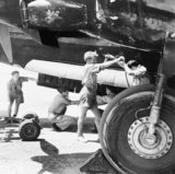 RAF armourers load a 250lb bomb into the bomb bay of a Wellington of No 38 Squadron, RAF Shallufa, Egypt, 1942