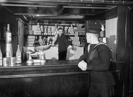 A sailor shopping in the NAAFI canteen on board the cross-channel steamer AUTOCARRIER, used as a recreation ship for the crews of Royal Navy auxiliary vessels, June 1943.