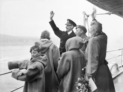The Norwegian Royal Family waving to welcoming crowds from HMS NORFOLK at Oslo, June 1945.