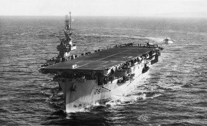 The aircraft carrier HMS SLINGER, December 1944.