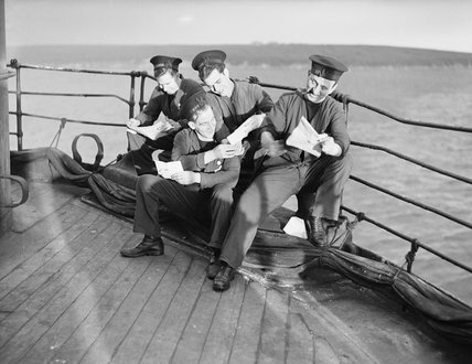 Sailors read their Christmas mail aboard HMS DUNLUCE CASTLE at Scapa Flow, December 1941.