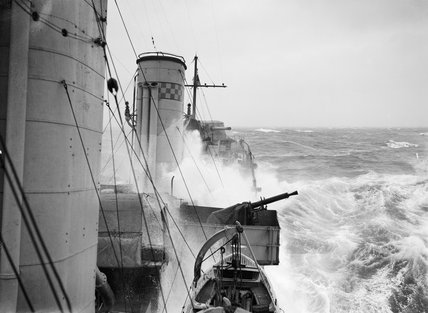 The view aft from a Royal Navy destroyer on an escort patrol in heavy seas in the Atlantic, October 1941.