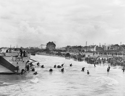 Follow-up waves of the 9th Canadian Infantry Brigade disembarking with bicycles from landing craft onto 'Nan White' sector of Juno Beach at Bernieres-sur-Mer, 6 June 1944.