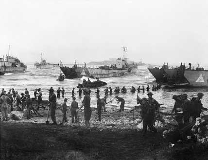 Troops from 51st Highland Division unloading stores from tank landing craft on the opening day of the Allied invasion of Sicily, 10 July 1943.