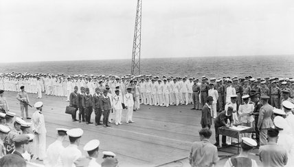 The ceremony marking the surrender of Japanese forces in New Britain, New Ireland, the Solomons and New Guinea, on the flight deck of HMS GLORY off Rabaul, 12 September 1945.