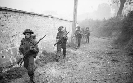 Men of 12 Platoon, 'B' Company, 6th Royal Scots Fusiliers advance into St Manvieu during Operation 'Epsom', Normandy, 26 June 1944.