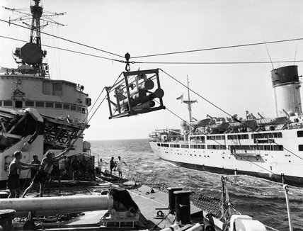 A Seaslug missile being transferred to HMS GIRDLE NESS from the RFA RETAINER during replenishment at sea trials in the Mediterranean, November 1959.