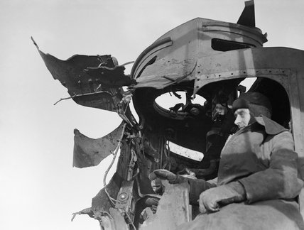 Damage to the director of the destroyer HMS SAUMAREZ which received a direct hit from an 11-inch shell during the Battle of North Cape, when the German battlecruiser SCHARNHOST was sunk on 10 January 1943.
