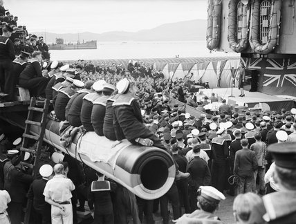 Phyllis Stanley is playing to a naval audience during a show on the packed deck of HMS NELSON, 7 January 1943.