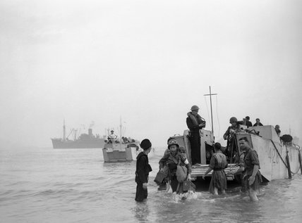 Troops and ammunition being brought ashore from LCAs (landing craft assault) at Arzeau in Algeria during Operation 'Torch', November 1942.