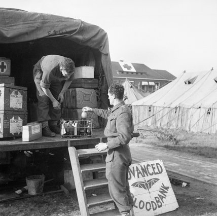 Blood supplies being drawn from an advanced blood bank, Holland, 5 October 1944.