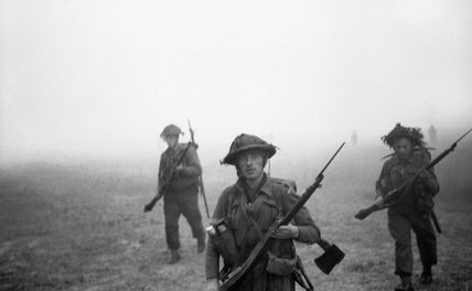 Men of 12 Platoon, 'B' Company, 6th Royal Scots Fusiliers advancing through mist and smoke at the start of Operation 'Epsom', Normandy, 26 June 1944