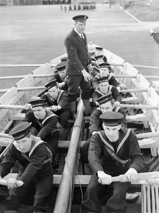 Naval recruits learn to row a boat at HMS RALEIGH, the naval training base at Torpoint in Cornwall, 1941.