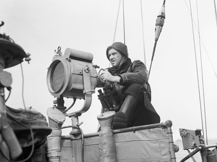 A signalman aboard HMS VISCOUNT, October 1942.