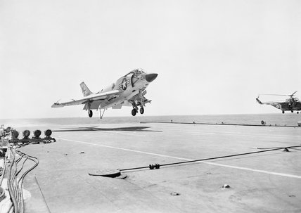 A US Navy Demon aircraft lands aboard HMS VICTORIOUS during an exercise in the South China Sea, November 1961.