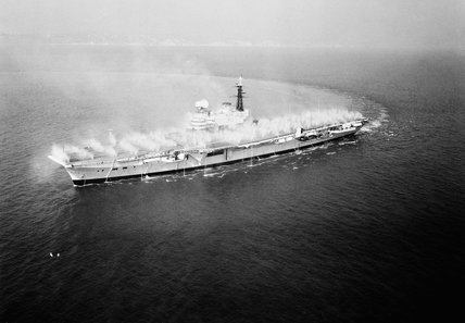 HMS HERMES testing her 'pre-wetting' system (designed to wash off radioactive fallout), June 1961.